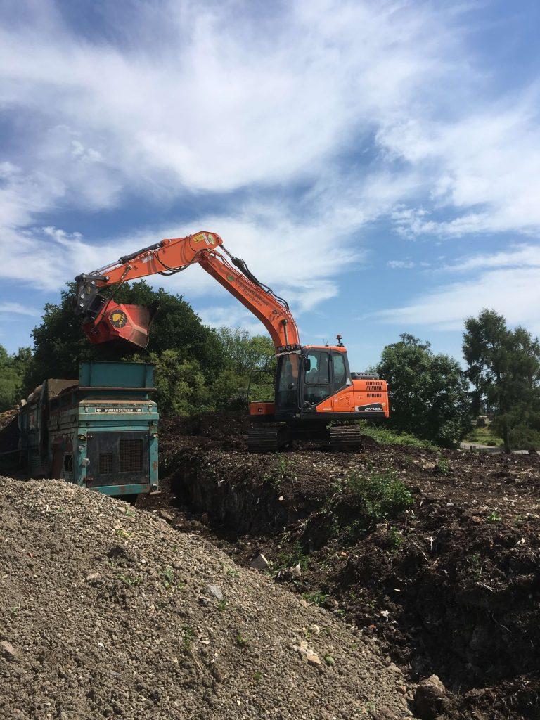 doosan dx140 excavator on site