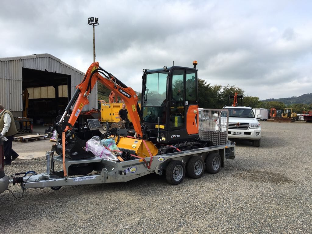 new doosan mini excavator with flail head attachment
