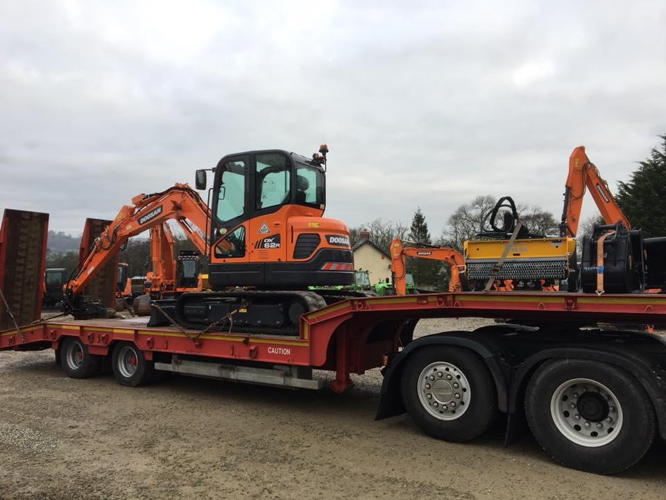 doosan excavator loaded for new customer in newport