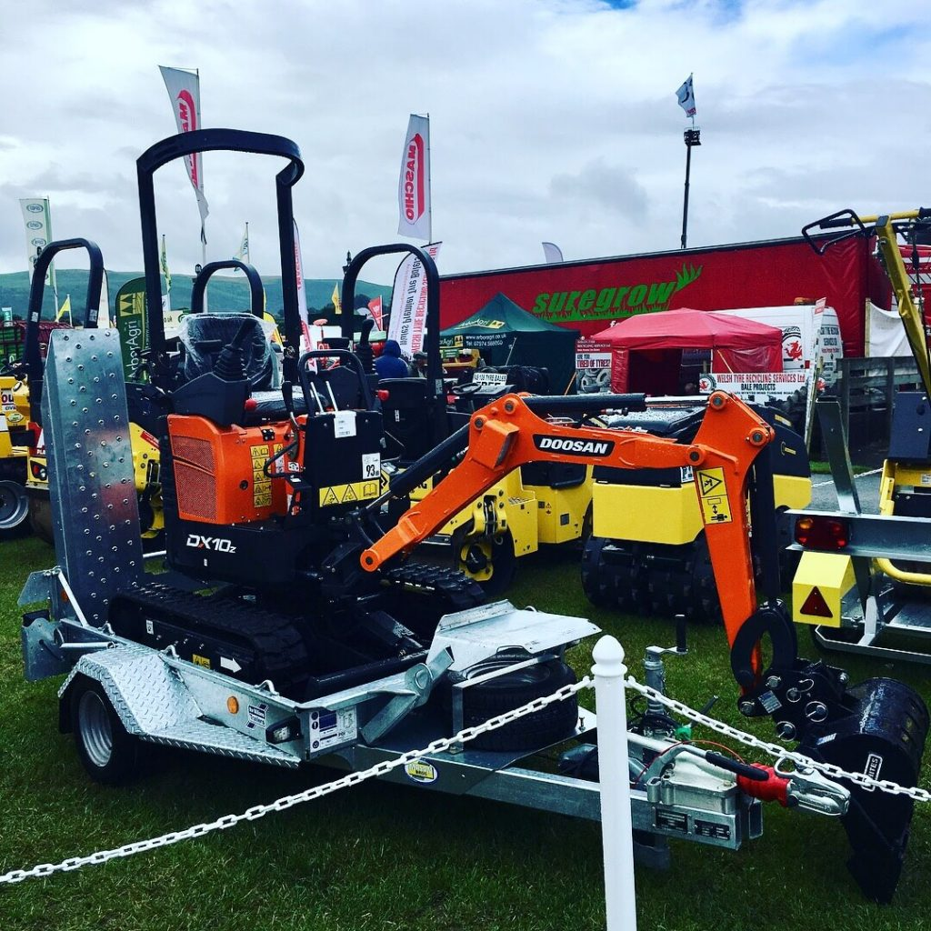 doosan micro digger on ifor williams plant trailer