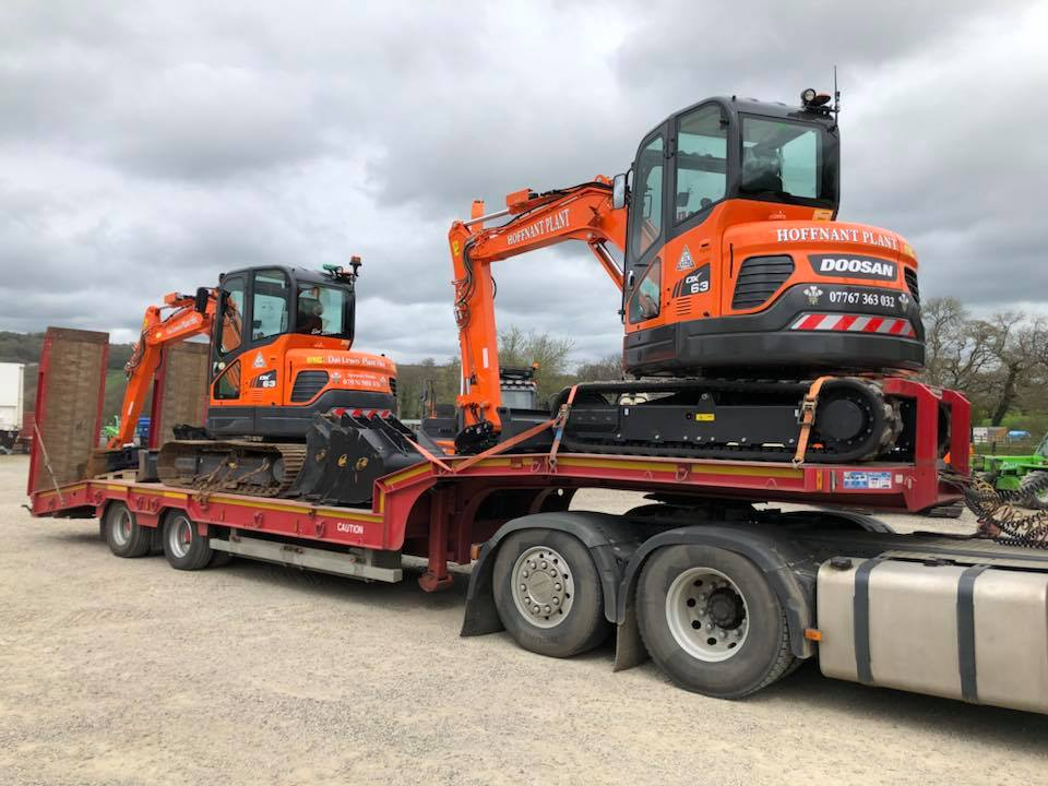 two new doosan excavators
