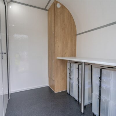 Separate Antechamber with Worktop, Fixed Storage and Deployable Plastic Storage Containers